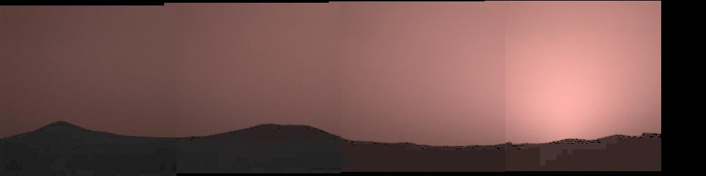 This image was taken by the Imager for NASA's Mars Pathfinder about one minute after sunset on Mars on Sol 21. The prominent hills dubbed 'Twin Peaks' form a dark silhouette at the horizon, while the setting sun casts a pink glow over the darkening sky.