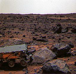 This color image shows NASA's Mars Pathfinder (MPF) Sojourner rover's Alpha Proton X-ray Spectrometer (APXS) deployed against the rock 'Moe' on the morning of Sol 65. This image was taken by by NASA's Mars Pathfinder (MPF).