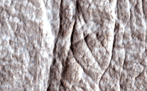 Dense clusters of crack-like structures called deformation bands form the linear ridges prominent in this image from the High Resolution Imaging Science Experiment (HiRISE) camera on NASA's Mars Reconnaissance Orbiter.