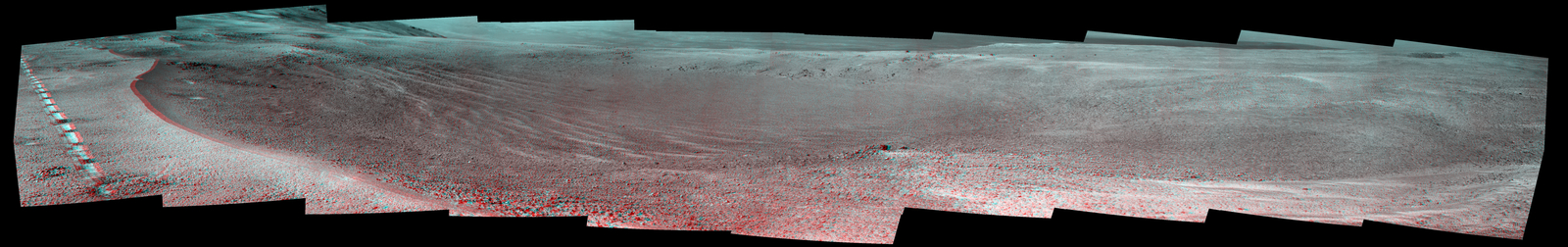 "This view of a 90-foot-wide, relatively fresh crater on Mars, ""Orion Crater,"" combines images from the left eye and right eye of the Panoramic Camera (Pancam) on NASA's Mars Exploration Rover Opportunity. It appears three-dimensional when seen through blue-red glasses with the red lens on the left."