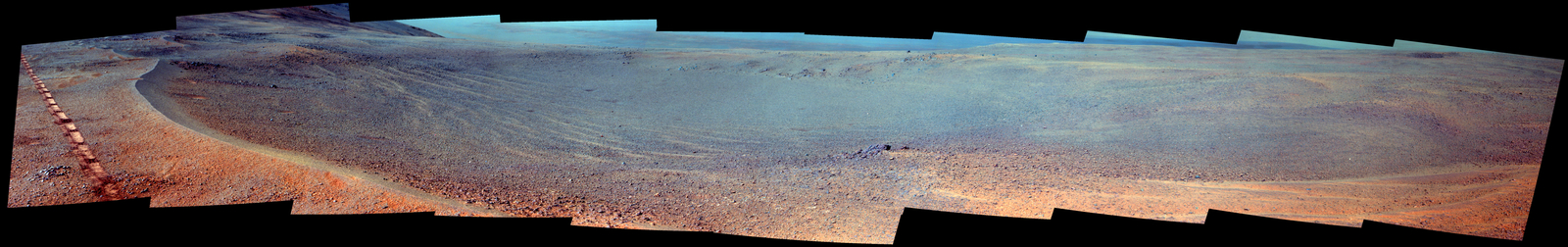 "The Pancam on NASA's Opportunity Mars rover imaged this small, relatively fresh crater in April 2017, during the 45th anniversary of the Apollo 16 mission to the moon. The rover team chose to call it ""Orion Crater,"" after the Apollo 16 lunar module. The scene is presented here in enhanced color."