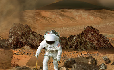 This image shows a backward-looking view of an astronaut in a white spacesuit hiking over reddish sand and rocks on Mars. A gray plume of smoke rises from a fumarole behind the astronaut.