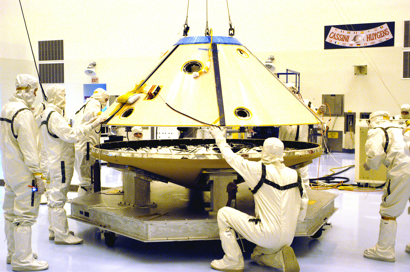 Technicians maneuver the aeroshell for Mars Exploration Rover 2 onto a workstand in the Payload Hazardous Servicing Facility.