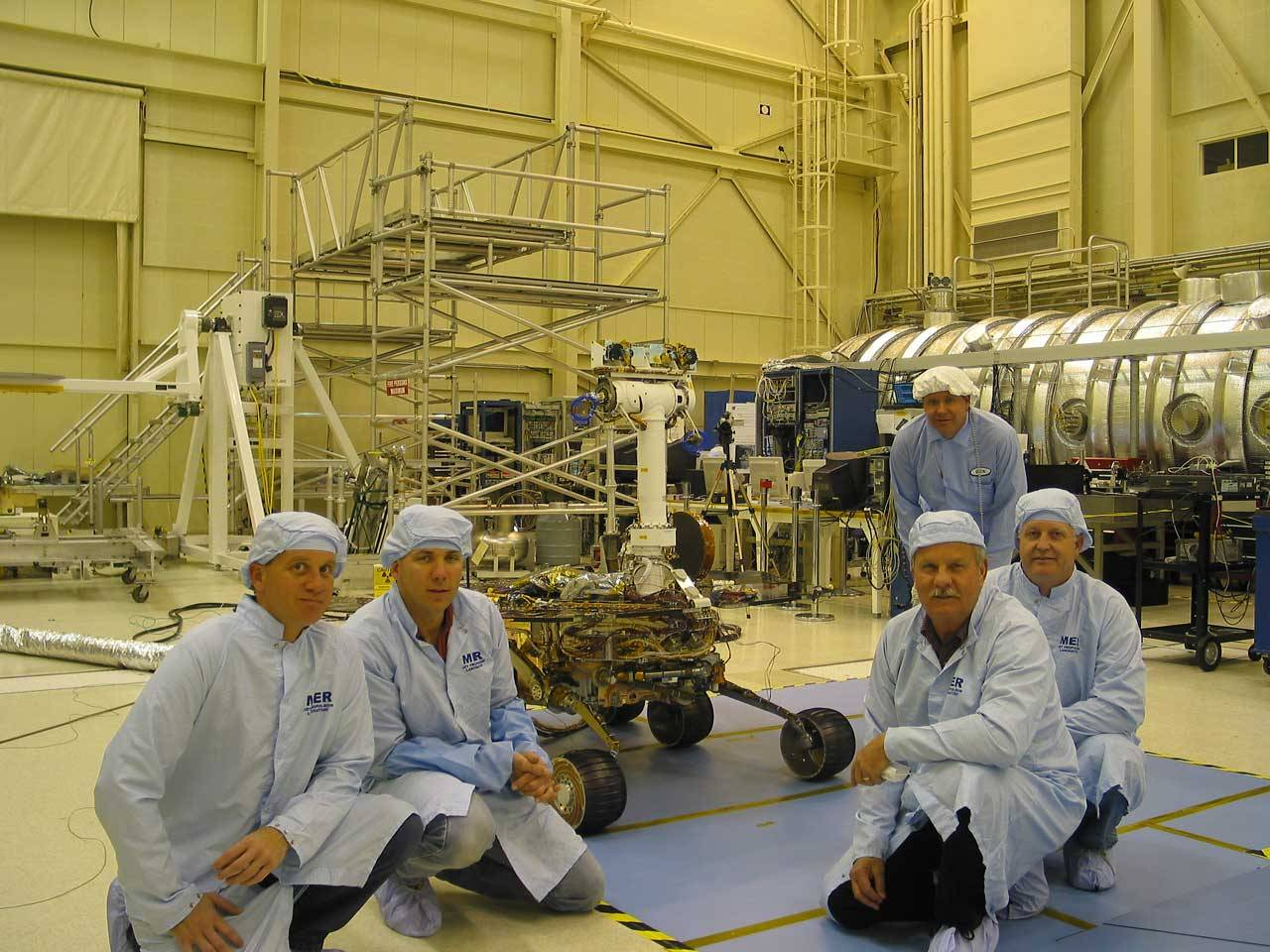 Rover team members with rover.