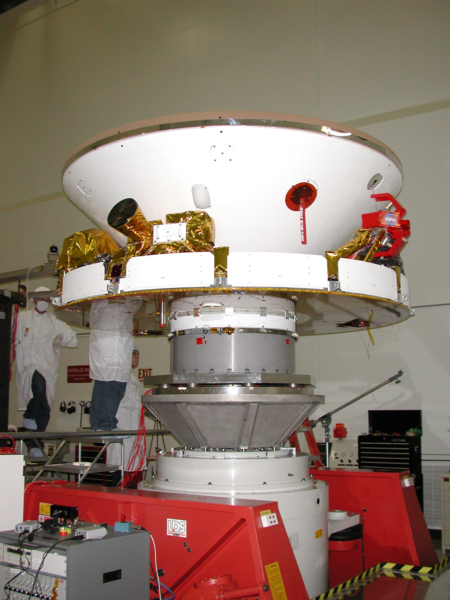 In this photo, engineers are preparing the rover for vibration testing to ensure that it can undergo the rigors of launch and entry into the martian atmosphere. The rovers are scheduled to launch next spring and will arrive at Mars in January 2004.