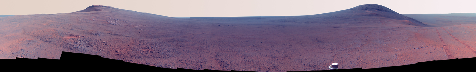 "This June 2017 view  from the Pancam on NASA's Opportunity Mars rover shows the area just above  ""Perseverance Valley"" on the western rim of Endeavour Crater. Color  has been enhanced to make differences in surface materials more easily."