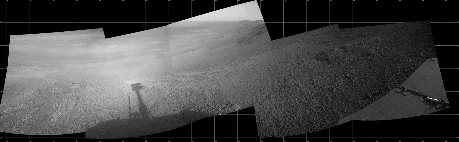 "This July 7, 2017, scene from the Navcam on NASA's Opportunity Mars rover shows a view from the upper end of ""Perseverance Valley"" on the inner slope of Endeavour Crater's rim.  At left, the valley descends about 200 yards to the crater floor. In the middle, the crater rim extends southeastward."