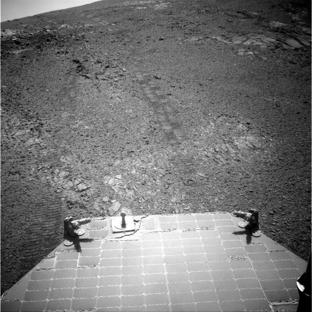 "This July 18, 2017, image from the navigation camera (Navcam) on the mast of NASA's Mars Exploration Rover Opportunity provides a look back to the crest of Endeavour Crater's rim after the rover began descending ""Perseverance Valley"" on the rim's inner slope."