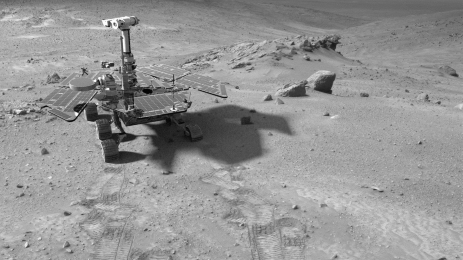 "This synthetic image of the Spirit Mars Exploration Rover in the ""Columbia Hills"" was produced using ""Virtual Presence in Space"" technology."