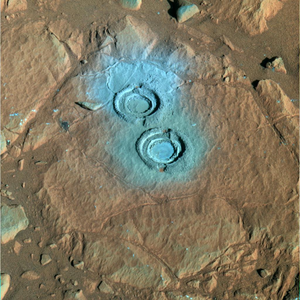 "The rock abrasion tool on NASA's Mars Exploration Rover Spirit ground two holes in a relatively soft rock called ""Wooly Patch"" near the base of the ""Columbia Hills"" inside Gusev Crater on Mars."