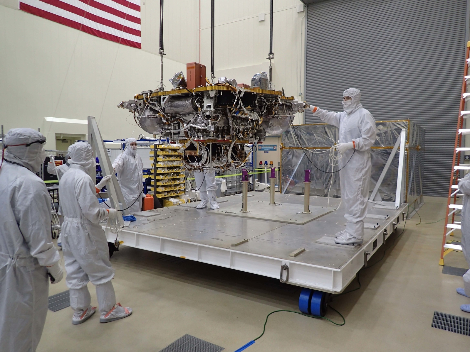 The Mars lander portion of NASA's InSight spacecraft is lifted from the base of a storage container in preparation for testing, in this photo taken June 20, 2017, in a Lockheed Martin clean room facility in Littleton, Colorado.