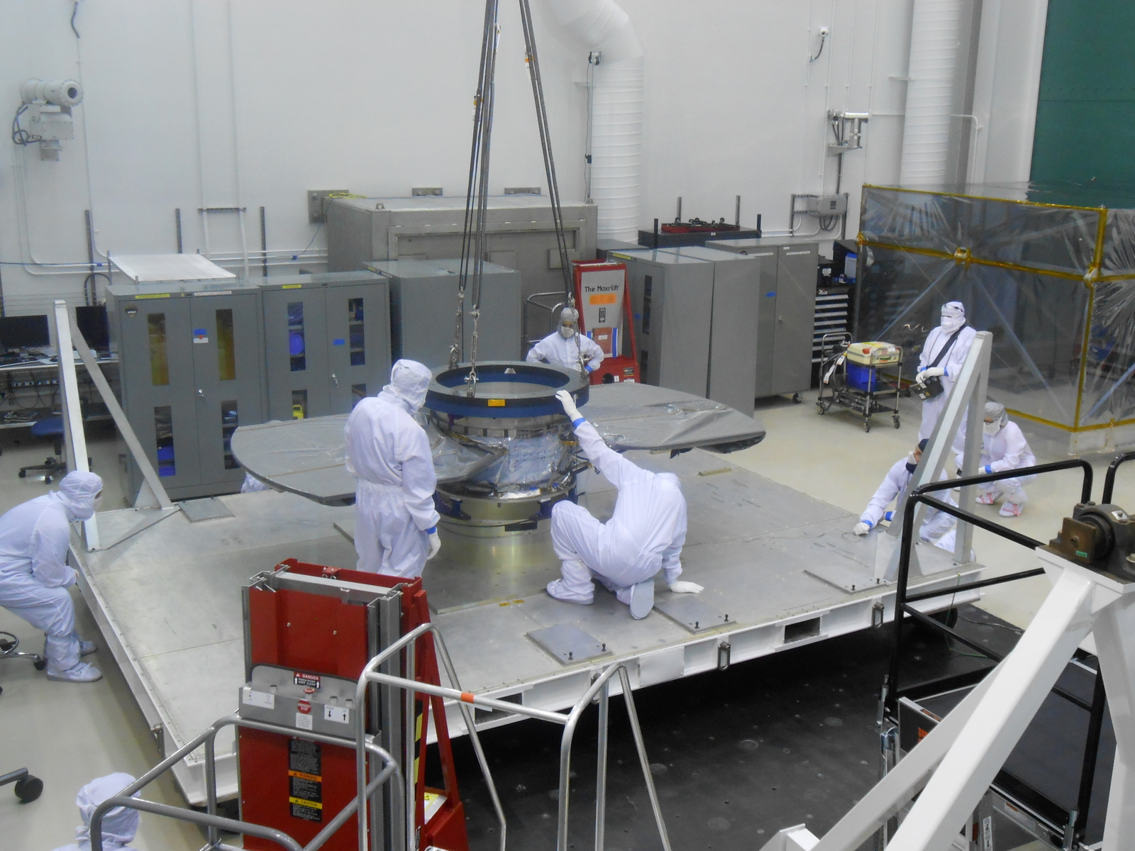 Lockheed Martin spacecraft specialists check the cruise stage of NASA's InSight spacecraft in this June 22, 2017, photo. The cruise stage will provide vital functions during the flight from Earth to Mars, and then will be jettisoned before the rest of the spacecraft enters Mars' atmosphere.