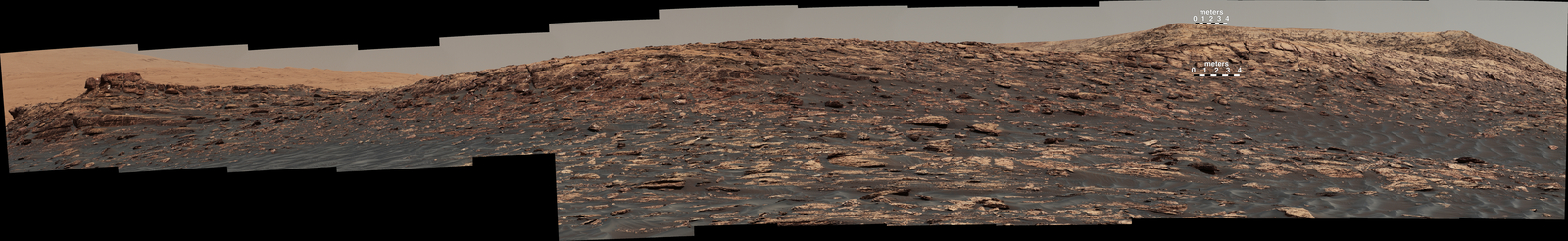 """Vera Rubin Ridge,"" a favored destination for NASA's Curiosity Mars rover even before the rover landed in 2012, rises near the rover nearly five years later in this panorama from Curiosity's Mast Camera (Mastcam).  Two scale bars of 4 meters (13.1 feet) provide size information for features near the bottom of the ridge and at the highest point visible on the ridge."