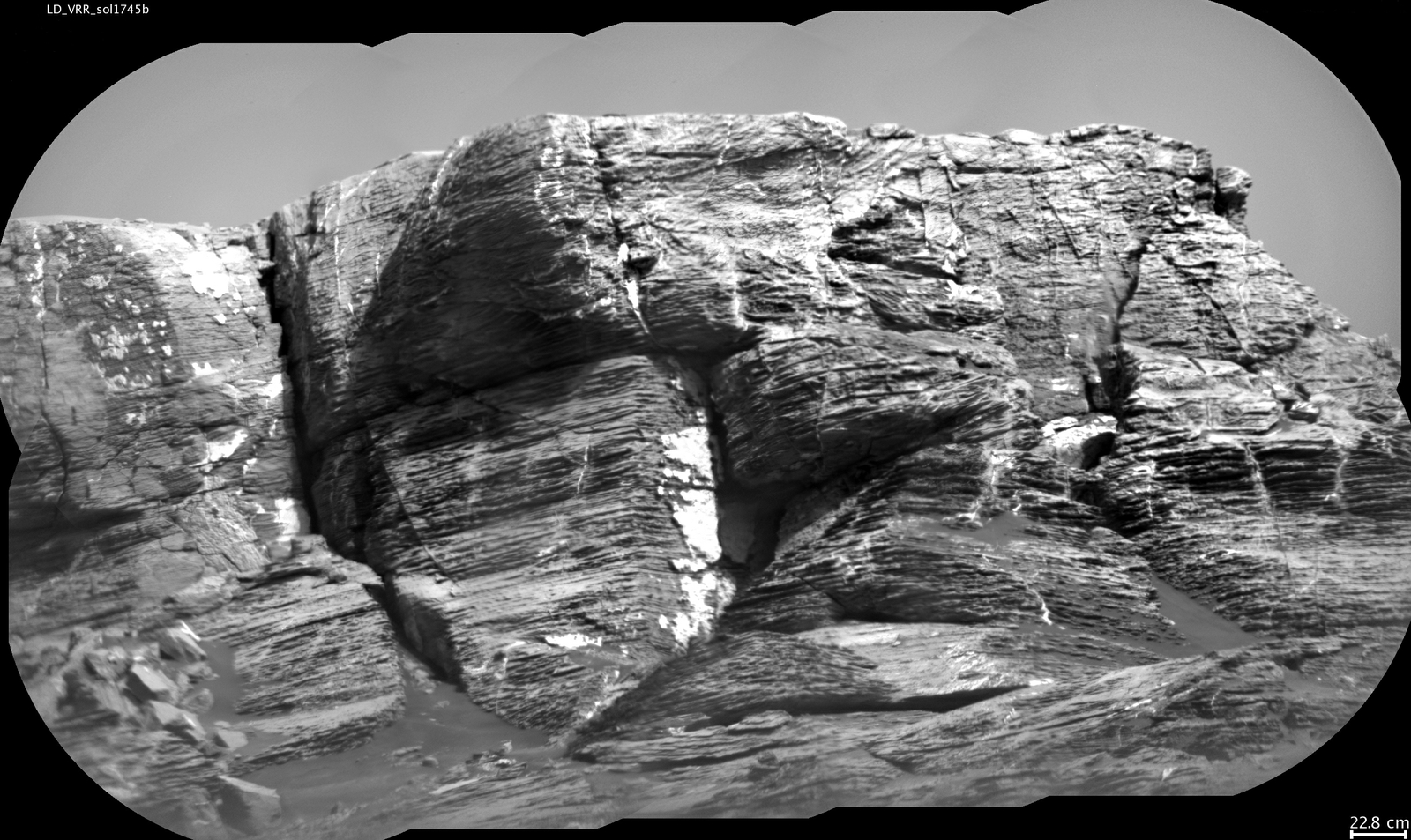 "This view of ""Vera Rubin Ridge"" from the ChemCam instrument on NASA's Curiosity Mars rover shows sedimentary layers and fracture-filling mineral deposits. ChemCam's telescopic Remote Micro-Imager took the 10 component images of this scene on July 3, 2017, from a distance of about 377 feet."