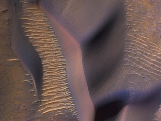 This image from NASA's Mars Reconnaissance Orbiter shows sand dunes on the slopes of Nectaris Montes within Coprates Chasma.