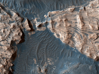This image from NASA's Mars Reconnaissance Orbiter shows Aram Chaos, a 280-kilometer-wide impact crater in the Southern Highlands. Uplifted blocks of hematite and water-altered silicates indicate that this crater once held a lake.