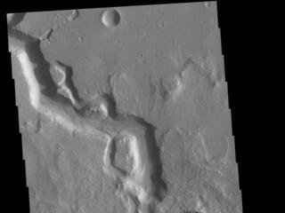 Hephaestus Fossae Crater