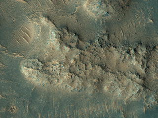 This image, acquired on May 13, 2018 by NASA's Mars Reconnaissance Orbiter, shows sand dunes scouring what appears to be a highly-cratered, old lava flow in the Tempe Terra region, located in the Northern Hemisphere.