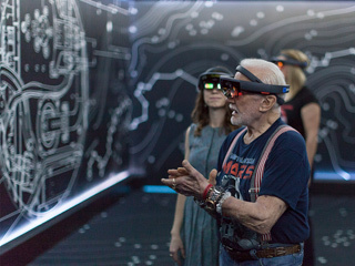 "Apollo 11 astronaut Buzz Aldrin and Erisa Hines of NASA's Jet Propulsion Laboratory in Pasadena, California, try out the Microsoft HoloLens mixed-reality headset during a preview of ""Destination: Mars"" at Kennedy Space Center visitor complex in Florida."