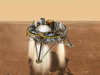 This is an illustration showing a simulated view of NASA's InSight about to land on the surface of Mars. This view shows the top of the spacecraft.