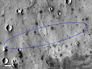 The red dot marks the final landing location of NASA's InSight lander in this annotated image of the surface of Mars, taken by the THEMIS camera on NASA's 2001 Mars Odyssey orbiter in 2015.