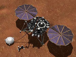 This artist's concept shows NASA's InSight lander with its instruments deployed on the Martian surface. Several of the sensors used for studying Martian weather are visible on its deck, including the inlet for an air pressure sensor and the east- and west-facing weather sensor booms.