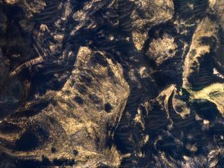 Jumbled Blocks on the Floor of Melas Chasma