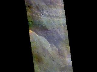 This image from NASAs Mars Odyssey shows a small part of the extensive volcanic plains located east of Olympus Mons.