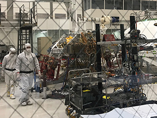 Technicians working Mars 2020's System's Test 1 approach their workstation in the Spacecraft Assembly Facility at NASA's Jet Propulsion Laboratory in Pasadena, Calif.