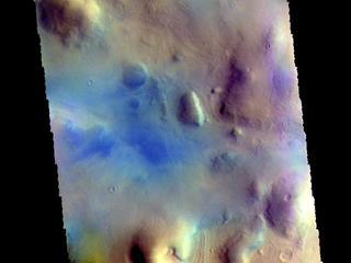 This image from NASAs Mars Odyssey shows part of northern Terra Sabaea. Blue tones in false color images usually indicate basaltic sand.