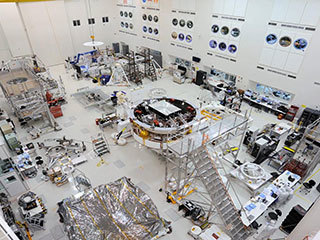 This image shows major components of NASA's Mars 2020 mission in the High Bay 1 clean room in JPL's Spacecraft Assembly Facility.