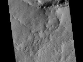 This image from NASAs Mars Odyssey shows part of the rim of an unnamed crater in Terra Cimmeria.