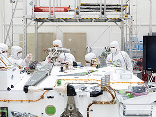 Mars 2020 engineers and technicians installed the high-gain antenna on the rover's equipment deck in the Spacecraft Assembly Facility's High Bay 1 clean room at JPL.