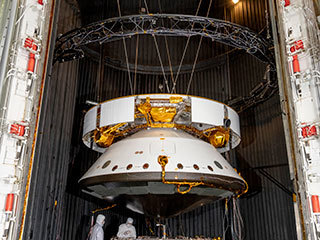 Engineers prepare the Mars 2020 spacecraft for a thermal vacuum (TVAC) test in the Space Simulator Facility at NASA's Jet Propulsion Laboratory in Pasadena, California.