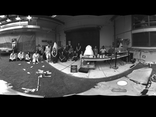 "This 360-degree panorama was taken by ""Dusty,"" a fully-working replica of the Opportunity rover at JPL. Members of the Opportunity team gathered to sit in during the panorama."