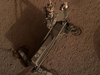 "The support structure of the Heat Flow and Physical Properties Package (HP3) instrument moved slightly during hammering, as indicated by the circular ""footprints"" around the instrument's footpads."