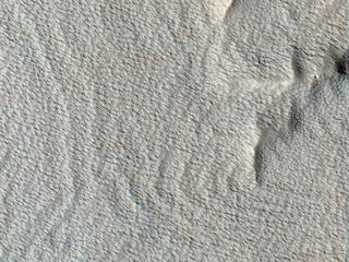 This image, acquired on October 1, 2018 by NASAs Mars Reconnaissance Orbiter, shows a wavy surface like that of the sea. These wave shapes are the result of erosion.