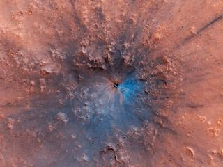 This image, acquired by NASAs Mars Reconnaissance Orbiter, shows a new impact crater that has appeared on the surface of Mars, formed at most between September 2016 and February 2019.