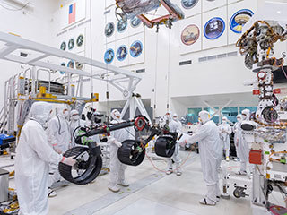 In this image, taken on June 13, 2019, engineers prepare the starboard legs and wheels — otherwise known as the mobility suspension — for integration onto NASA's Mars 2020 rover.