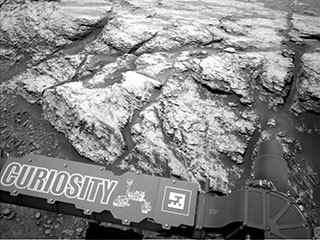 "This image was taken by the left Navcam on NASA's Curiosity Mars rover on June 18, 2019, the 2,440th Martian day, or sol, of the mission. It shows part of ""Teal Ridge,"" which the rover has been studying within a region called the ""clay-bearing unit."""