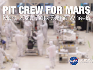 A team of engineers at NASA's Jet Propulsion Laboratory in Pasadena, California, install the legs and wheels — otherwise known as the mobility suspension — on the Mars 2020 rover. The imagery for this accelerated time-lapse was taken on June 13, 2019, from a camera above the Spacecraft Assembly Facility's High Bay 1 clean room.