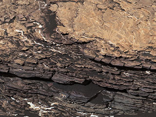 "This mosaic of images shows a boulder-sized rock called ""Strathdon,"" which is made up of many complex layers. NASA's Curiosity Mars rover took these images using its Mast Camera, or Mastcam, on July 9, 2019, the 2,461st Martian sol, or day, of the mission."