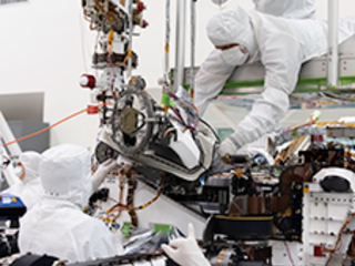 In this August 5, 2019 image, the bit carousel - the heart of sampling and caching subsystem of NASA's Mars 2020 mission -  is attached to the front end of the rover.
