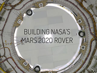 See NASA's next Mars rover quite literally coming together inside a clean room at the Jet Propulsion Laboratory.