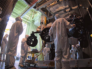 In this time-lapse video taken at JPL, engineers move the Mars 2020 rover into a large vacuum chamber for testing in Mars-like environmental conditions.