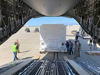 ​​The shipping container carrying NASA's Mars 2020 rover is readied for loading aboard an Air Force C-17 transport plane at March Air Reserve Base in Riverside, California, on Feb. 11, 2020.