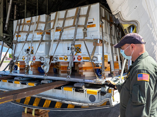 Perseverance mission flight hardware, test gear and equipment delivered to Kennedy Space Center is unloaded from a NASA Wallops C-130.