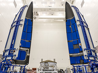Inside the Payload Hazardous Servicing Facility at NASA's Kennedy Space Center in Florida, the Perseverance rover is being prepared for encapsulation in the United Launch Alliance Atlas V payload fairing on June 18, 2020. The rover is scheduled to launch in summer 2020 atop the Atlas V rocket from Cape Canaveral Air Force Station.