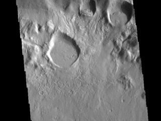 This image from NASAs Mars Odyssey shows part of the crater rim and floor of an unnamed crater located in Terra Sirenum on the north rim of Newton Crater.