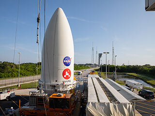 nose cone containing the Mars 2020 Perseverance rover sits atop a motorized payload transporter
